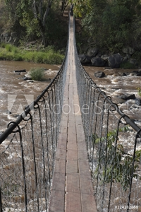 Bild på A long suspension bridge over a river in the maasai mara national reserve;Maasai mara kenya