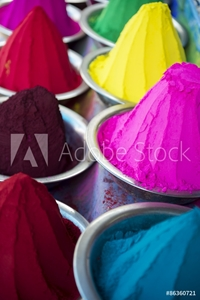Bild på Colorful piles of Indian bindi powder dye at outdoor local Devaraja Market in Mysore India blue, yellow, red, green, pink, and purple