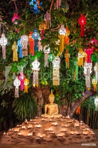 Bild på Buddha statue surounded by candles during Loy Kratong Festival,
