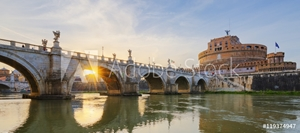 Bild på Holy Angel Bridge over the Tiber River in Rome at sunset.