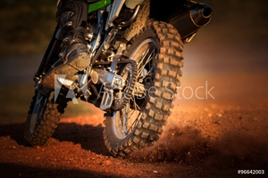 Bild på action of enduro motorcycle on dirt track