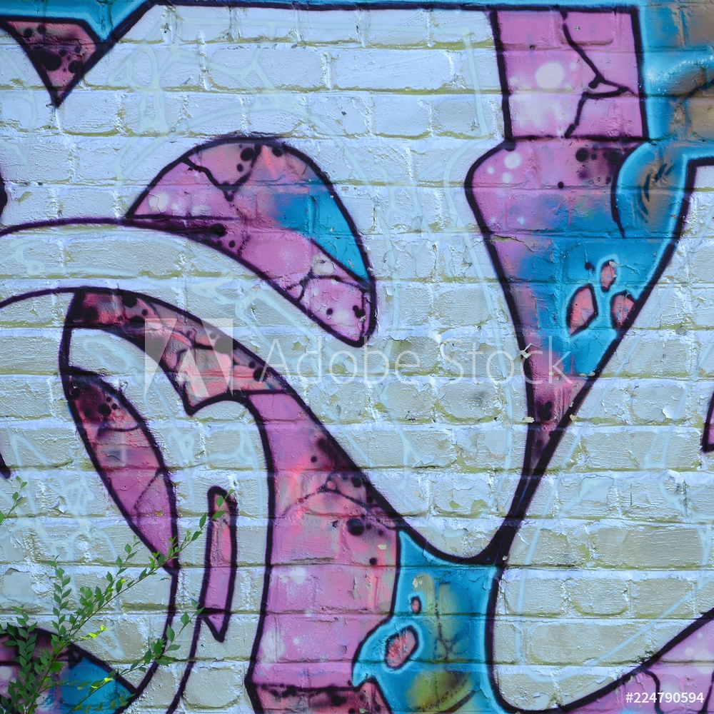 Bild på Fragment of graffiti drawings. The old wall decorated with paint stains in the style of street art culture. Colored background texture in purple tones